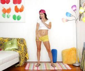 MILF pornstar Savannah Fyre showing off naked body wearing..