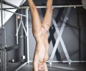 Picture- Suspended blonde in bdsm training