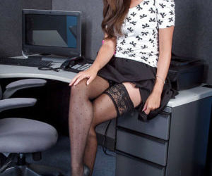 Cute secretary Allie Haze slides skirt down nylon covered..