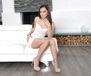 Petite babe Shrima Malatai posing fully clothed in white..
