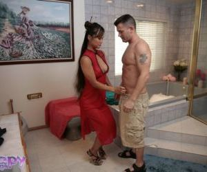 Oiled Asian milf Mia Smiles is doing the greatest handjob..