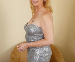 Mature lady Brandie Sweet hikes her dress over her head to..