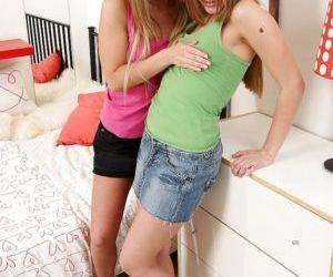 Lesbian teens Willa and Nastie masturbating their asses..