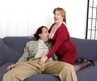 Fat older lady Penny Sue seduces her new lover in a red dress and black nylons