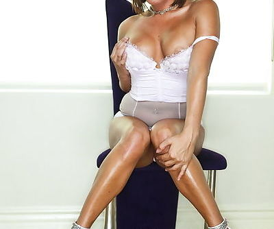 In sexy high heels she uses a dildo on her smoking hot pussy
