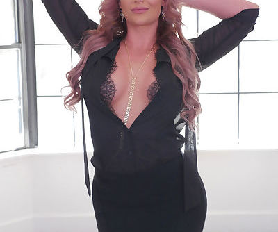 Curvy MILF Phoenix Marie shows off her wares in sensual lingerie