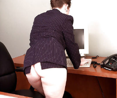 Plump MILF Desirae taking off business attire on her office desk