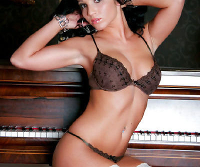 Mouthwatering hot chick Bunny curves and poses in fancy white stockings by an antique piano